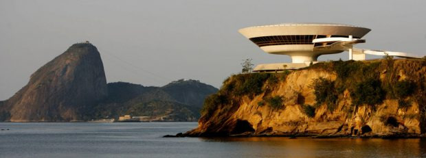 ** TO GO WITH NIEMEYER ** The Niteroi Contemporary Art Museum, designed by Oscar Niemeyer overlooks the famed landmark Sugar Loaf, left, in Niteroi, Brazil, Friday, Oct. 5, 2007.  As Niemeyer prepares for his 100th birthday on Dec. 15, he works every day at his Copacabana beach office on a desk full of projects and remains faithful to the curves that are the hallmark of his work. (AP Photo/Ricardo Moraes)